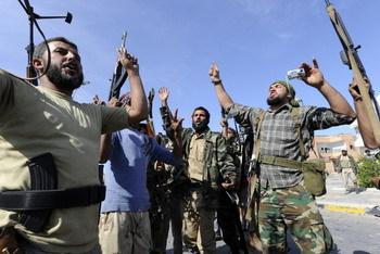 魏京生:卡扎菲暴政崩潰  中國箭在弦上