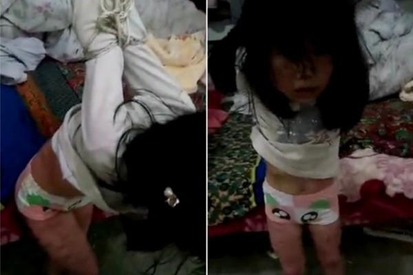 陆女童遭家暴被反绑虐打 不求饶也不哭闹(视频)
