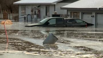 积雪降雨演变成暴洪 美内州多县被淹没